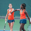 Florida junior Caroline Hitimana and senior Joanna Mather high fives during the Gators' 7-0 win against the FSU Seminoles on Wednesday, February 29, 2012 at the Alfred A Ring Tennis Complex in Gainesville, Fla. / Gator Country photo by Saj Guevara