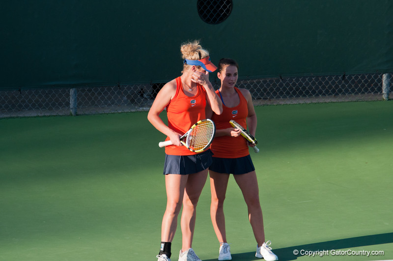 Florida junior Allie Will and Sophomore Sofie Oyen talk strategy during the Gators' 7-0 win against the FSU Seminoles on Wednesday, February 29, 2012 at the Alfred A Ring Tennis Complex in Gainesville, Fla. / Gator Country photo by Saj Guevara