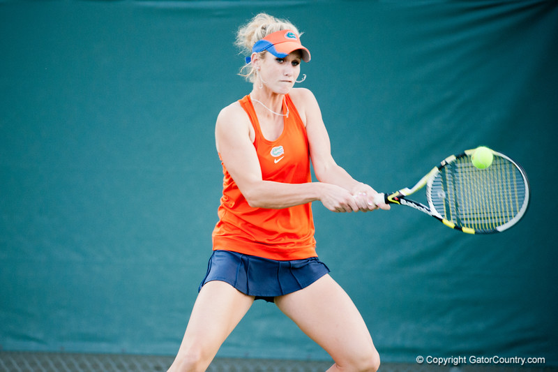 Florida junior Allie Will hits a backhand during the Gators' 7-0 win against the FSU Seminoles on Wednesday, February 29, 2012 at the Alfred A Ring Tennis Complex in Gainesville, Fla. / Gator Country photo by Saj Guevara