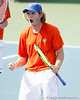 Florida freshman Andrew Butz celebrates after a doubles point during the Gators' 4-0 win against the Arkansas Razorbacks in the first round of the SEC tournament on Thursday, April 21, 2011 at Linder Stadium at Ring Tennis Complex in Gainesville, Fla. / Gator Country photo by Tim Casey