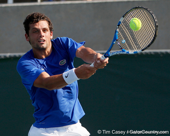 Florida senior Alexandre Lacroix hits the ball during the Gators' 4-0 win against the Arkansas Razorbacks in the first round of the SEC tournament on Thursday, April 21, 2011 at Linder Stadium at Ring Tennis Complex in Gainesville, Fla. / Gator Country photo by Tim Casey