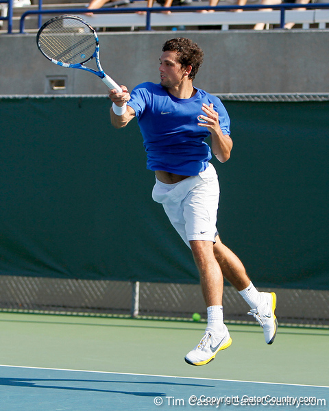 Florida senior Alexandre Lacroix leaps in the air during the Gators' 4-0 win against the Arkansas Razorbacks in the first round of the SEC tournament on Thursday, April 21, 2011 at Linder Stadium at Ring Tennis Complex in Gainesville, Fla. / Gator Country photo by Tim Casey