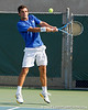 Florida senior Alexandre Lacroix attacks the ball during the Gators' 4-0 win against the Arkansas Razorbacks in the first round of the SEC tournament on Thursday, April 21, 2011 at Linder Stadium at Ring Tennis Complex in Gainesville, Fla. / Gator Country photo by Tim Casey