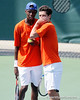 Florida sophomore Sekou Bangoura, Jr. talks with senior Alexandre Lacroix during the Gators' 4-0 win against the Arkansas Razorbacks in the first round of the SEC tournament on Thursday, April 21, 2011 at Linder Stadium at Ring Tennis Complex in Gainesville, Fla. / Gator Country photo by Tim Casey