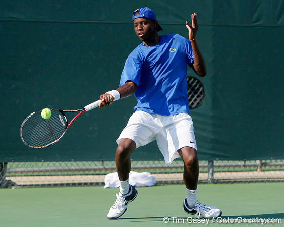 Florida sophomore Sekou Bangoura, Jr. returns the bal during the Gators' 4-0 win against the Arkansas Razorbacks in the first round of the SEC tournament on Thursday, April 21, 2011 at Linder Stadium at Ring Tennis Complex in Gainesville, Fla. / Gator Country photo by Tim Casey