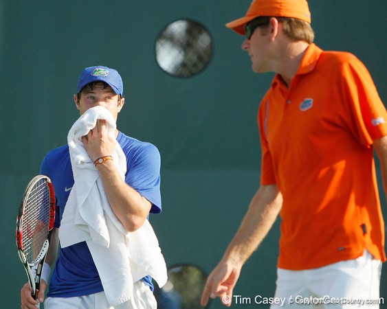 Florida freshman Spencer Newman talks with men's tennis head coach Andy Jackson during the Gators' 4-0 win against the Arkansas Razorbacks in the first round of the SEC tournament on Thursday, April 21, 2011 at Linder Stadium at Ring Tennis Complex in Gainesville, Fla. / Gator Country photo by Tim Casey