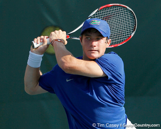 Florida freshman Spencer Newman follows through on a swing during the Gators' 4-0 win against the Arkansas Razorbacks in the first round of the SEC tournament on Thursday, April 21, 2011 at Linder Stadium at Ring Tennis Complex in Gainesville, Fla. / Gator Country photo by Tim Casey