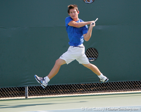 Florida sophomore Billy Federhofer leaps in the air during the Gators' 4-0 win against the Arkansas Razorbacks in the first round of the SEC tournament on Thursday, April 21, 2011 at Linder Stadium at Ring Tennis Complex in Gainesville, Fla. / Gator Country photo by Tim Casey