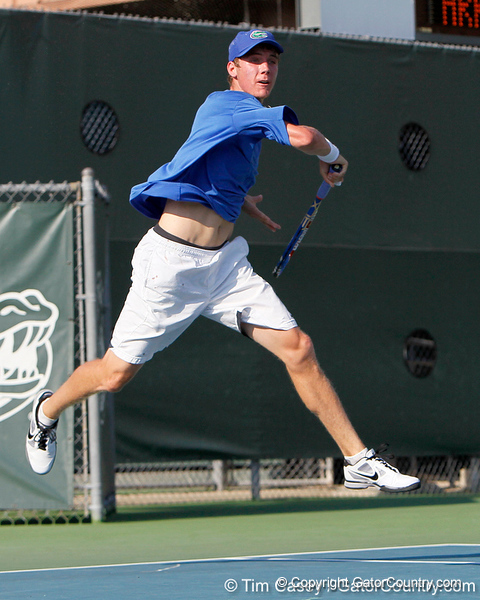 Florida sophomore Bob van Overbeek follows through on a volley during the Gators' 4-0 win against the Arkansas Razorbacks in the first round of the SEC tournament on Thursday, April 21, 2011 at Linder Stadium at Ring Tennis Complex in Gainesville, Fla. / Gator Country photo by Tim Casey