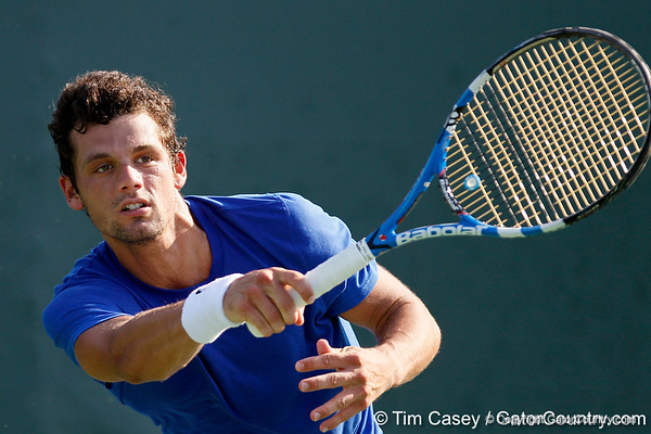 Florida senior Alexandre Lacroix finishes a swing during the Gators' 4-0 win against the Arkansas Razorbacks in the first round of the SEC tournament on Thursday, April 21, 2011 at Linder Stadium at Ring Tennis Complex in Gainesville, Fla. / Gator Country photo by Tim Casey
