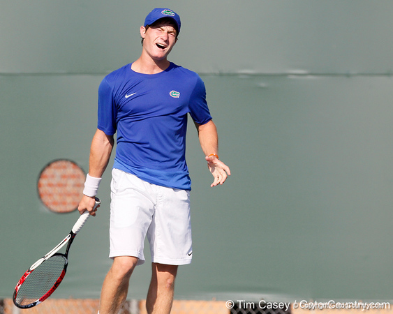 Florida freshman Spencer Newman reacts after a point during the Gators' 4-0 win against the Arkansas Razorbacks in the first round of the SEC tournament on Thursday, April 21, 2011 at Linder Stadium at Ring Tennis Complex in Gainesville, Fla. / Gator Country photo by Tim Casey