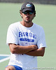 Florida student assistant men's tennis coach Antoine Benneteau watches during the Gators' 4-0 win against the Arkansas Razorbacks in the first round of the SEC tournament on Thursday, April 21, 2011 at Linder Stadium at Ring Tennis Complex in Gainesville, Fla. / Gator Country photo by Tim Casey