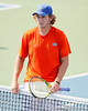 Florida freshman Andrew Butz shakes hands after winning a doubles match during the Gators' 4-0 win against the Arkansas Razorbacks in the first round of the SEC tournament on Thursday, April 21, 2011 at Linder Stadium at Ring Tennis Complex in Gainesville, Fla. / Gator Country photo by Tim Casey