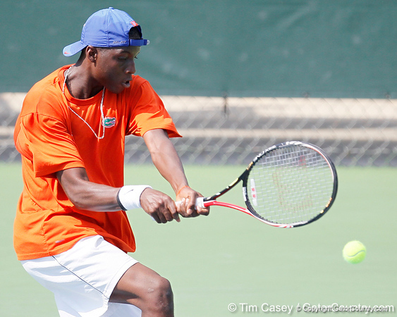 Florida sophomore Sekou Bangoura, Jr. hits the ball during the Gators' 4-0 win against the Arkansas Razorbacks in the first round of the SEC tournament on Thursday, April 21, 2011 at Linder Stadium at Ring Tennis Complex in Gainesville, Fla. / Gator Country photo by Tim Casey