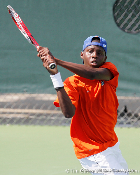Florida sophomore Sekou Bangoura, Jr. follows through during the Gators' 4-0 win against the Arkansas Razorbacks in the first round of the SEC tournament on Thursday, April 21, 2011 at Linder Stadium at Ring Tennis Complex in Gainesville, Fla. / Gator Country photo by Tim Casey
