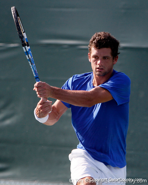 Florida senior Alexandre Lacroix watches the ball during the Gators' 4-0 win against the Arkansas Razorbacks in the first round of the SEC tournament on Thursday, April 21, 2011 at Linder Stadium at Ring Tennis Complex in Gainesville, Fla. / Gator Country photo by Tim Casey