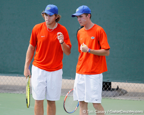Florida freshman Andrew Butz talks with sophomore Bob van Overbeek during the Gators' 4-0 win against the Arkansas Razorbacks in the first round of the SEC tournament on Thursday, April 21, 2011 at Linder Stadium at Ring Tennis Complex in Gainesville, Fla. / Gator Country photo by Tim Casey