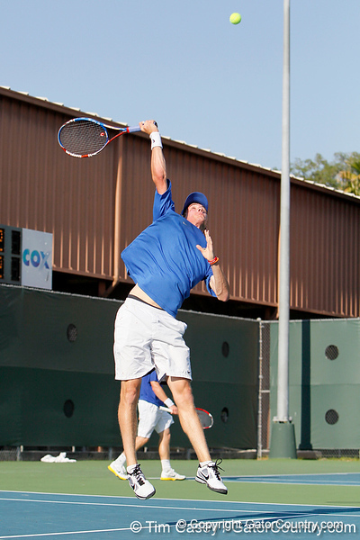 Florida sophomore Bob van Overbeek leaps for a volley during the Gators' 4-0 win against the Arkansas Razorbacks in the first round of the SEC tournament on Thursday, April 21, 2011 at Linder Stadium at Ring Tennis Complex in Gainesville, Fla. / Gator Country photo by Tim Casey