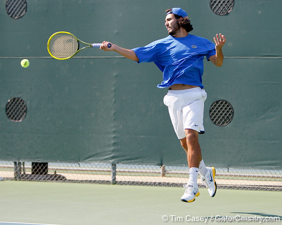 Florida junior Nassim Slilam attacks the ball during the Gators' 4-0 win against the Arkansas Razorbacks in the first round of the SEC tournament on Thursday, April 21, 2011 at Linder Stadium at Ring Tennis Complex in Gainesville, Fla. / Gator Country photo by Tim Casey
