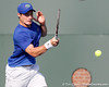 Florida freshman Spencer Newman attacks the ball during the Gators' 4-0 win against the Arkansas Razorbacks in the first round of the SEC tournament on Thursday, April 21, 2011 at Linder Stadium at Ring Tennis Complex in Gainesville, Fla. / Gator Country photo by Tim Casey
