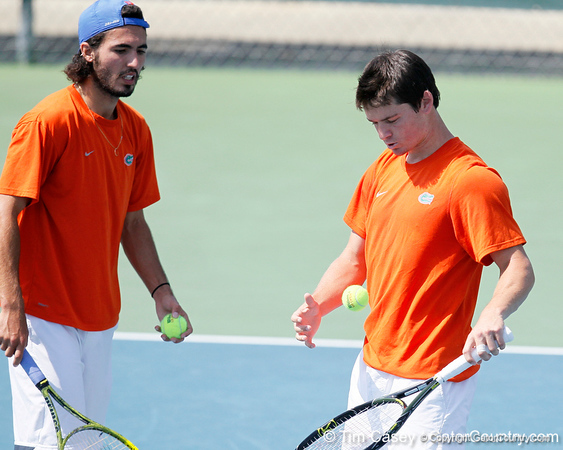 Florida junior Nassim Slilam talks with sophomore Billy Federhofer during the Gators' 4-0 win against the Arkansas Razorbacks in the first round of the SEC tournament on Thursday, April 21, 2011 at Linder Stadium at Ring Tennis Complex in Gainesville, Fla. / Gator Country photo by Tim Casey