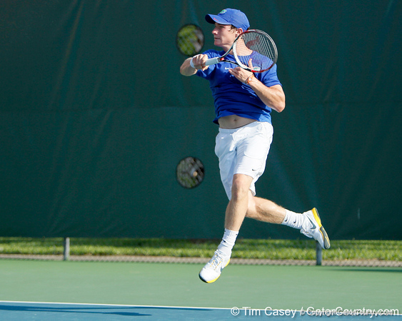 Florida freshman Spencer Newman leaps after a swing during the Gators' 4-0 win against the Arkansas Razorbacks in the first round of the SEC tournament on Thursday, April 21, 2011 at Linder Stadium at Ring Tennis Complex in Gainesville, Fla. / Gator Country photo by Tim Casey