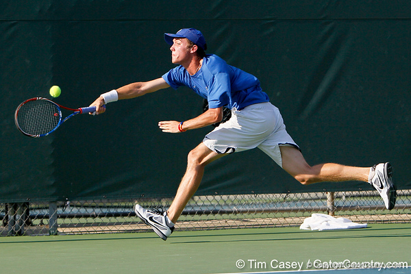 Florida sophomore Bob van Overbeek reaches for a ball during the Gators' 4-0 win against the Arkansas Razorbacks in the first round of the SEC tournament on Thursday, April 21, 2011 at Linder Stadium at Ring Tennis Complex in Gainesville, Fla. / Gator Country photo by Tim Casey