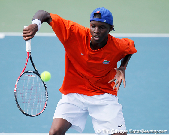 Florida sophomore Sekou Bangoura, Jr. volleys a ball close to the net during the Gators' 4-0 win against the Arkansas Razorbacks in the first round of the SEC tournament on Thursday, April 21, 2011 at Linder Stadium at Ring Tennis Complex in Gainesville, Fla. / Gator Country photo by Tim Casey