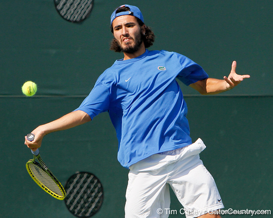 Florida junior Nassim Slilam swings at the ball during the Gators' 4-0 win against the Arkansas Razorbacks in the first round of the SEC tournament on Thursday, April 21, 2011 at Linder Stadium at Ring Tennis Complex in Gainesville, Fla. / Gator Country photo by Tim Casey