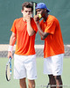 Florida senior Alexandre Lacroix talks with sophomore Sekou Bangoura, Jr. during the Gators' 4-0 win against the Arkansas Razorbacks in the first round of the SEC tournament on Thursday, April 21, 2011 at Linder Stadium at Ring Tennis Complex in Gainesville, Fla. / Gator Country photo by Tim Casey