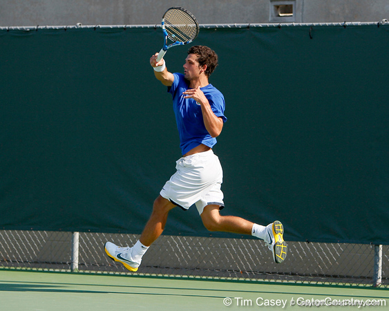 Florida senior Alexandre Lacroix watches his volley during the Gators' 4-0 win against the Arkansas Razorbacks in the first round of the SEC tournament on Thursday, April 21, 2011 at Linder Stadium at Ring Tennis Complex in Gainesville, Fla. / Gator Country photo by Tim Casey