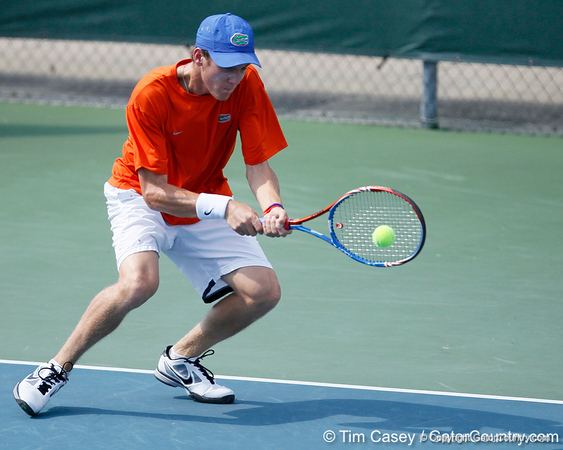 Florida sophomore Bob van Overbeek hits the ball during the Gators' 4-0 win against the Arkansas Razorbacks in the first round of the SEC tournament on Thursday, April 21, 2011 at Linder Stadium at Ring Tennis Complex in Gainesville, Fla. / Gator Country photo by Tim Casey