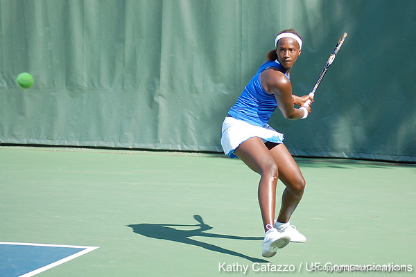 Florida sophomore Caroline Hitimana eyes the ball during the Gators' 4-3 win against top-seeded Stanford to win the 2011 NCAA Championship on Tuesday at Taube Tennis Stadium on the campus of Stanford University in Palo Alto, Calif. / UF Communications photo by Kathy Cafazzo