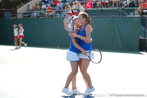Florida freshman Sofie Oyen and sophomore Lauren Embree celebrate after winning a doubles point during the Gators' 4-3 win against top-seeded Stanford to win the 2011 NCAA Championship on Tuesday at Taube Tennis Stadium on the campus of Stanford University in Palo Alto, Calif. / UF Communications photo by Kathy Cafazzo