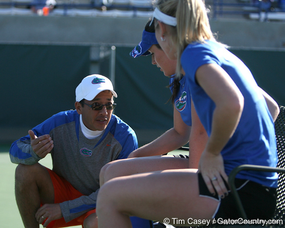 Florida volunteer assistant coach Mark Tija talks with senior Anastasia Revzina during the Gators' 7-0 win against the South Florida Bulls on Monday, February 8, 2010 at Linder Stadium at Ring Tennis Complex in Gainesville, Fla. / Gator Country photo by Tim Casey