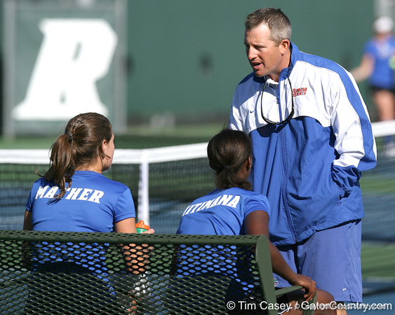 Florida associate head coach Dave Balogh talks with Joanna Mather and Caroline Hitimana during the Gators' 7-0 win against the South Florida Bulls on Monday, February 8, 2010 at Linder Stadium at Ring Tennis Complex in Gainesville, Fla. / Gator Country photo by Tim Casey