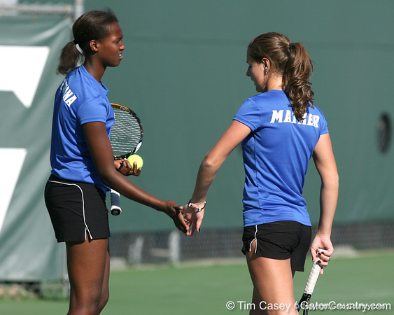 Florida freshman Caroline Hitimana and sophomore Joanna Mather compete during the Gators' 7-0 win against the South Florida Bulls on Monday, February 8, 2010 at Linder Stadium at Ring Tennis Complex in Gainesville, Fla. / Gator Country photo by Tim Casey