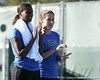 Florida freshman Caroline Hitimana and sophomore Joanna Mather watch a doubles match during the Gators' 7-0 win against the South Florida Bulls on Monday, February 8, 2010 at Linder Stadium at Ring Tennis Complex in Gainesville, Fla. / Gator Country photo by Tim Casey
