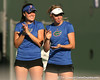 Florida senior Anastasia Revzina and freshman Lauren Embree watch a doubles match during the Gators' 7-0 win against the South Florida Bulls on Monday, February 8, 2010 at Linder Stadium at Ring Tennis Complex in Gainesville, Fla. / Gator Country photo by Tim Casey
