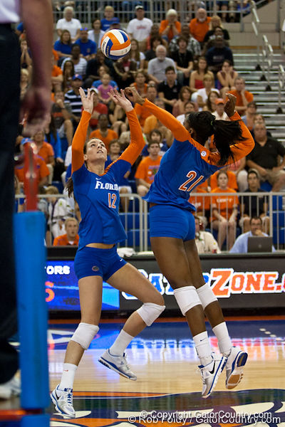 Florida senior Kelly Murphy (12) sets the ball for senior Cassandra Anderson (21) during the Gators' 3-0 win against Boston College on Friday, August 26, 2011 at the Stephen C. O'Connell Center in Gainesville, Fla. / Gator Country photo by Rob Foldy