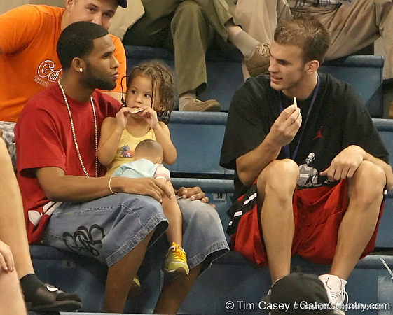 photo by Tim Casey<br /> <br /> UF senior guard Walter Hodge, his daughter and Nick Calathes talk during the Gators' sweep of the South Carolina Gamecock on Wednesday, October 15, 2008 at the Stephen C. O'Connell Center in Gainesville, Fla.