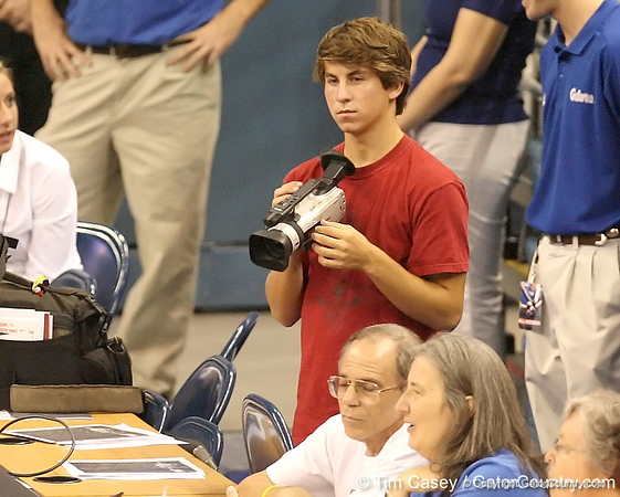 photo by Tim Casey<br /> <br /> Gator Country videographer Jesse Walker works during the Gators' sweep of the South Carolina Gamecock on Wednesday, October 15, 2008 at the Stephen C. O'Connell Center in Gainesville, Fla.