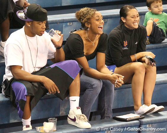 photo by Tim Casey<br /> <br /> Florida sophomore football player Joe Haden, junior soccer midfielder Ashlee Elliott and sophomore soccer defender Nicky Kit watch during the Gators' sweep of the South Carolina Gamecock on Wednesday, October 15, 2008 at the Stephen C. O'Connell Center in Gainesville, Fla.