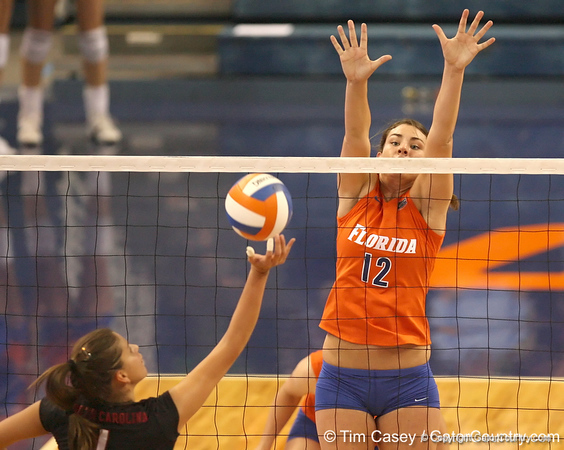 photo by Tim Casey<br /> <br /> Florida freshman setter/right-side hitter Kelly Murphy goes up the block during the Gators' sweep of the South Carolina Gamecock on Wednesday, October 15, 2008 at the Stephen C. O'Connell Center in Gainesville, Fla.