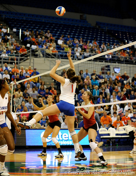 UF freshman Cindy Bathelt jumps to spike a shot made by Alabama in the second set. The Gators clinched their last home game with a 3-0 win over the Crimson Tide at the O'Connell Center on Saturday, November 23, 2008. (Casey Brooke Lawson / Gator Country)