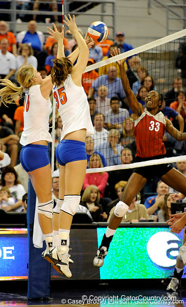 UF freshman Colleen Ward and senior Kelsey Bowers knock the ball over the net during the second set. The Gators clinched their last home game with a 3-0 win over the Crimson Tide at the O'Connell Center on Saturday, November 23, 2008. (Casey Brooke Lawson / Gator Country)