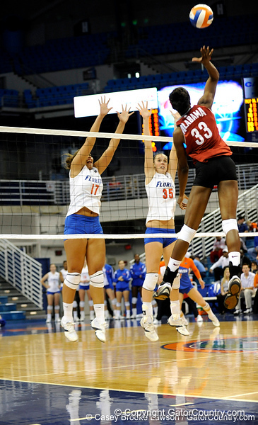 UF sophomore Lauren Bledsoe and senior Kelsey Bowers jump to block a shot by an Alabama player during the second set. The Gators clinched their last home game with a 3-0 win over the Crimson Tide at the O'Connell Center on Saturday, November 23, 2008. (Casey Brooke Lawson / Gator Country)