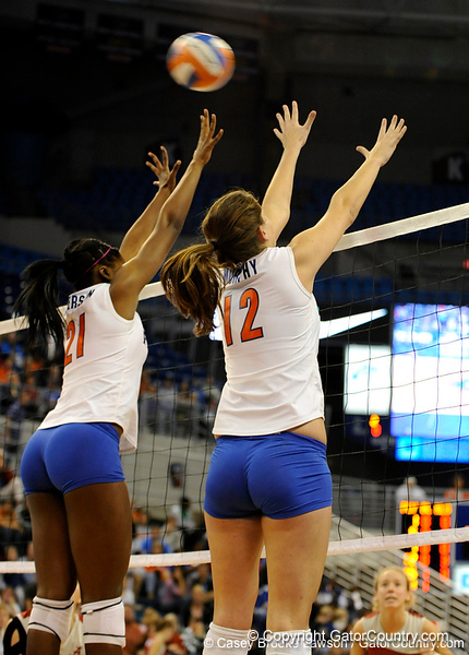UF freshman Cassandra Anderson and freshman Kelly Murphy jump to block a shot by Alabama in the second set. The Gators clinched their last home game with a 3-0 win over the Crimson Tide at the O'Connell Center on Saturday, November 23, 2008. (Casey Brooke Lawson / Gator Country)