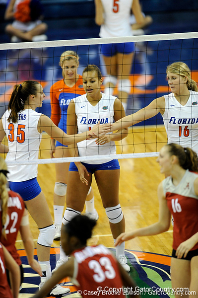 UF senior Kelsey Bowers high-fives freshman Colleen Ward after the Gator's score a point in the first set. The Gators clinched their last home game with a 3-0 win over the Crimson Tide at the O'Connell Center on Saturday, November 23, 2008. (Casey Brooke Lawson / Gator Country)