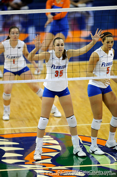 UF senior Kelsey Bowers, freshman Cindy Bathelt and sophomore Callie Rivers stand ready before the beginning of a new set. The Gators clinched their last home game with a 3-0 win over the Crimson Tide at the O'Connell Center on Saturday, November 23, 2008. (Casey Brooke Lawson / Gator Country)